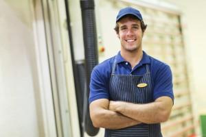 smiling carpenter standing in workshop
